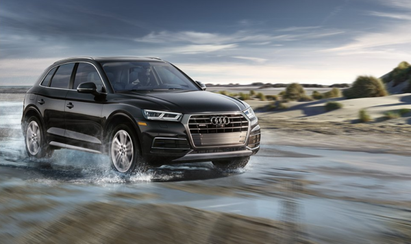 2018 Audi Q5 driving down a road covered in water
