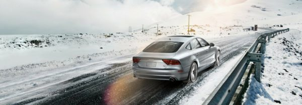 An Audi A7 driving down a snowy road featured in a blog post about Audi parts