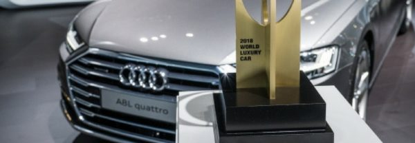 A close up of an Audi A8 L next to an award featured in a blog post about the New York International Auto Show