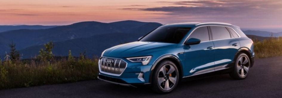 Blue 2019 Audi e-tron parked mountainside